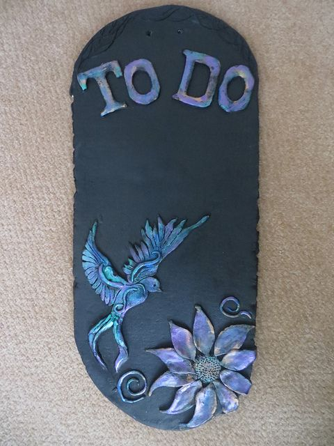 Blackboard paint on clay. Images painted with 'Rub n Buffs' and metallic paints.