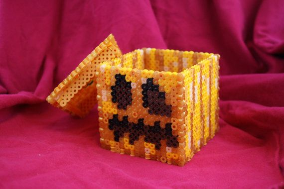 This is a digital download of a template that can be used to create a box inspired by the pumpkin/jack-o-lantern block from Minecraft with Perler...just made this last night after buying the pattern and it turned out awesome! Making a bunch for Halloween !