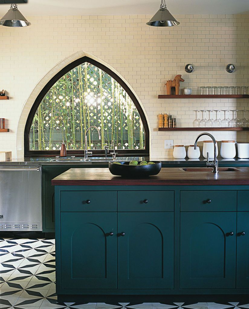Dark Teal Kitchen Cabinets: Hand-stamped Concrete From Mexico Runs Between The Kitchen
