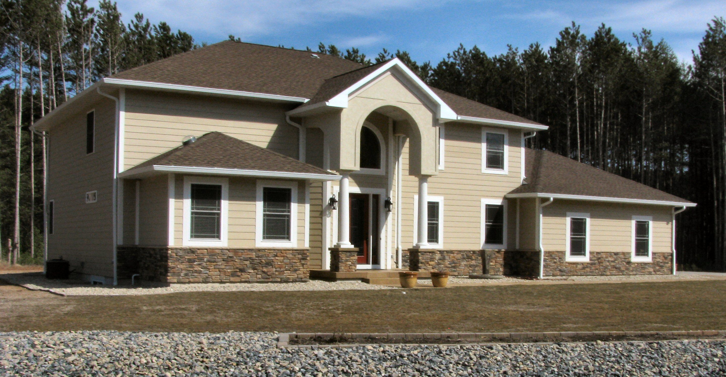 Custom built 3 516 sq ft two story in stevens point for Houses with stucco and siding
