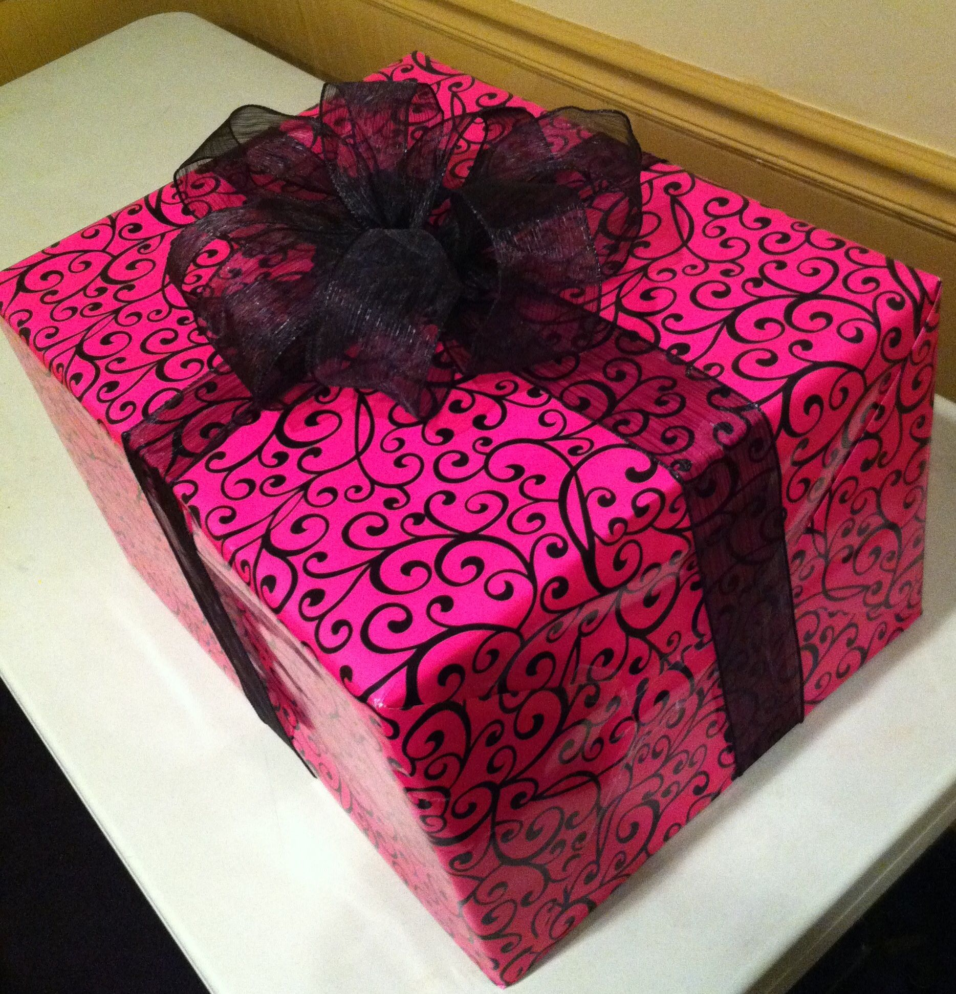 Hot Pink with black pattern sealed with sheered black ribbon ...