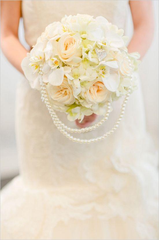 wedding bouquet with pearls #bouquet #pearls #weddingchicks http://www.weddingchicks.com/2014/02/19/glamorous-rose-gold-wedding/
