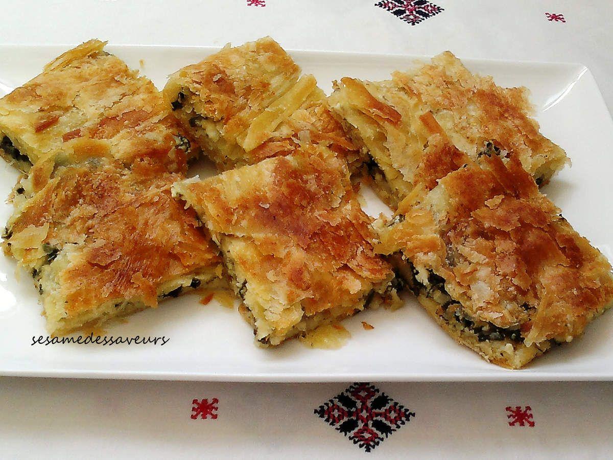 La technique de réalisation de ces Rghayef est la même que celle utilisée pour les Rghayef hyper feuilletés*. Le premier carré façonné est farci d'un mélange de Ricotta, de fromage râpé, d'oignons et d'épinards, il est enveloppé successivement de fines...