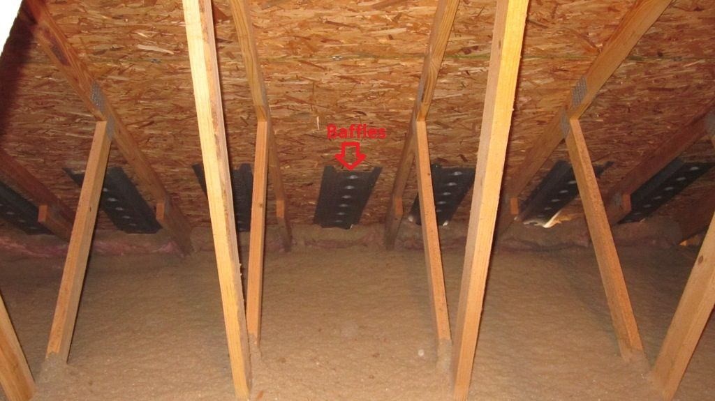 Insulation Baffles On Recycled Cellulose Layer In Attic
