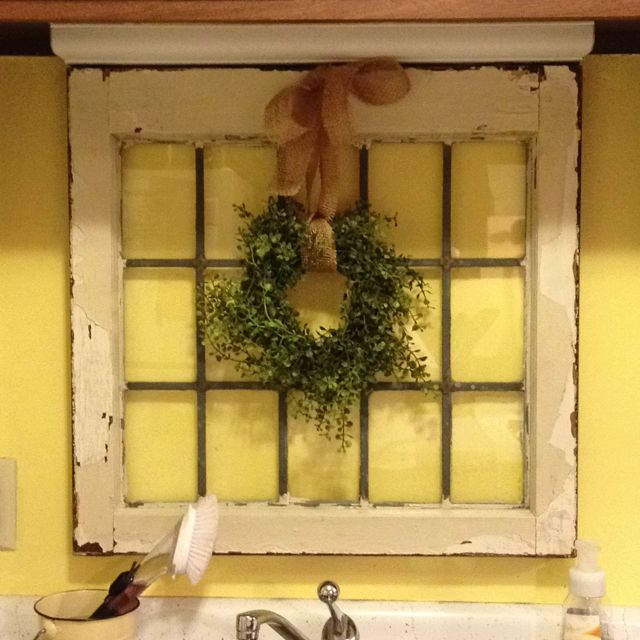 Homemade boxwood wreath over antique window frame for for Old wooden windows craft ideas