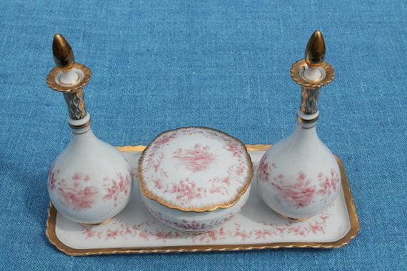 This set is in perfect condition with no cracks, crazing, or chips. The set is made of creamy porcelain with reddish pink hand painted flowers,