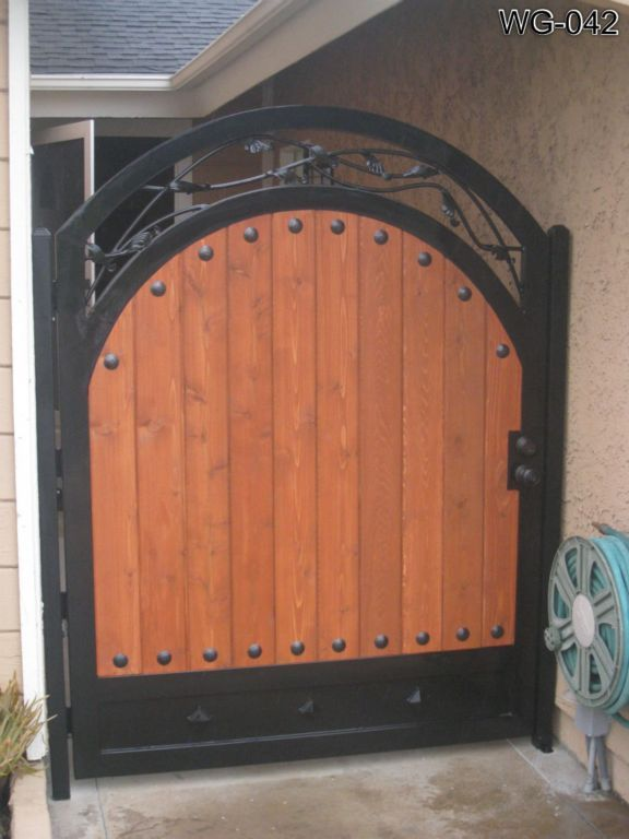 Wooden Gates Wood Doors Advanced Iron Concepts In 2020 Wooden Gates Iron Garden Gates Garden Gate Design