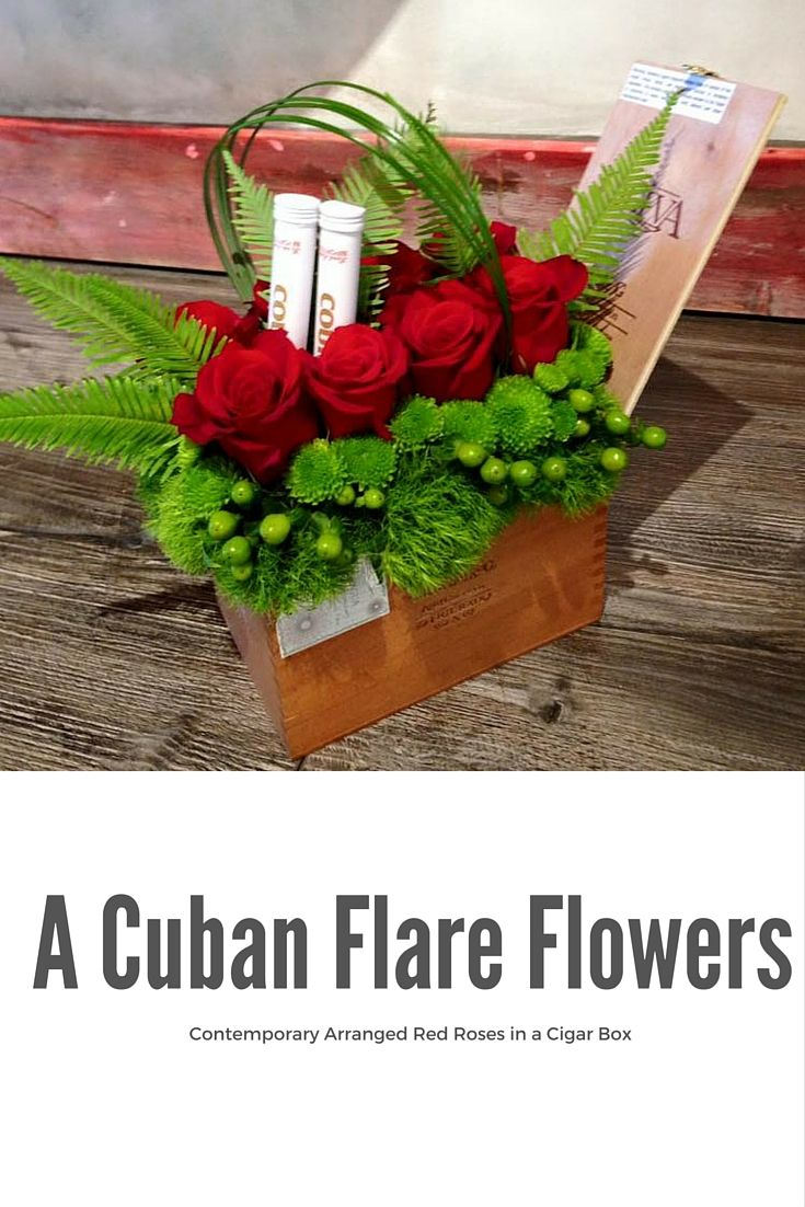 A Cuban Flare Contemporary Arranged red roses in a Cigar