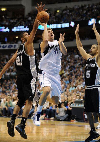 Spurs   shot against Tim Duncan #21 and Ime Udoka #5 of the San Antonio Spurs ...