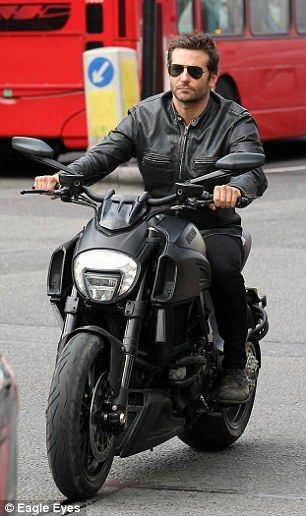 a0c0e91f Bradley Cooper is the epitome of cool as he rides past landmarks ...