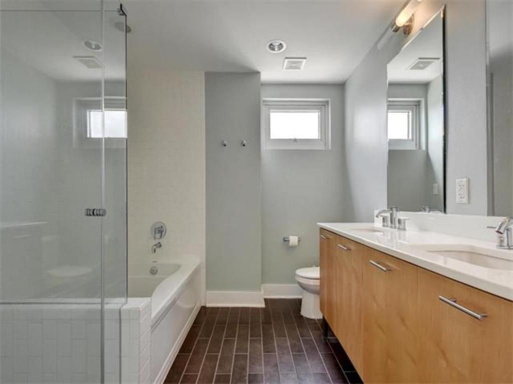 Large tub, walk-in shower and clean-looking, white countertops 603 ...