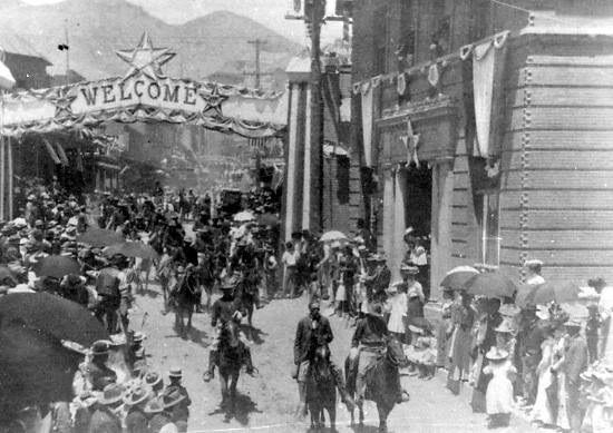 The 1902 Fourth of July Parade going down Main Street in Bisbee, Arizona. This image is from the Bisbee Mining & Historical Museum photograph collection. #Holiday #Bisbee #FourthofJuly #July4th #parade