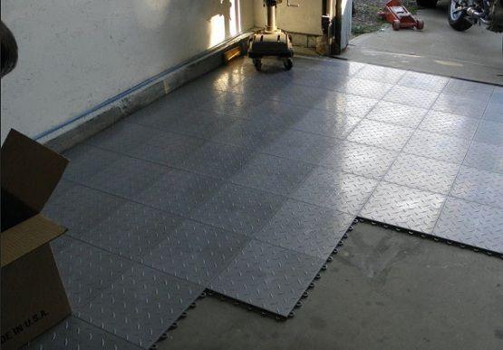 Interlocking Garage Floor Tiles Installed In Concrete Floor