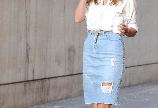 Tip: Don't Fear Distressed Denim One rip or two won't kill ya. To ensure you're maintaining an elevated ensemble, pair your distressed denim skirt with a sleek (and tucked in) button-down. Then throw on a skinny belt for good measure