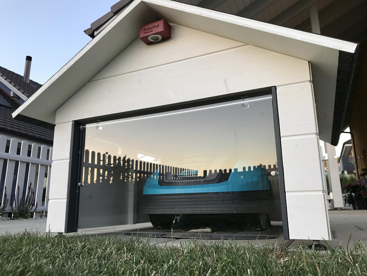 2017 Version Of Robotic Lawn Mower Garage Switzerland S Cooles Robotic Lawn Mower Garage With Solar Led Lights Inside Robotic Lawn Mower Diy Lawn Lawn Mower