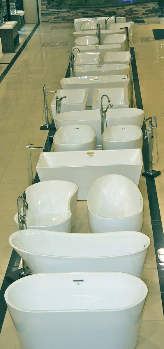 an aerial view of a long row of free-standing bathtubs at tubs's