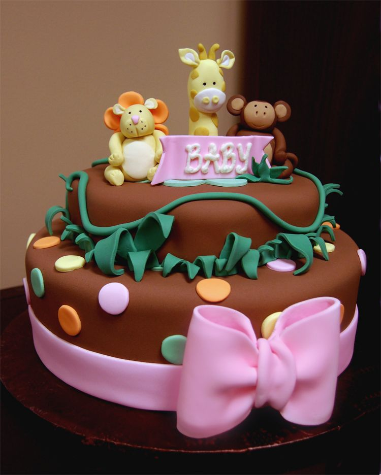 Baby shower jungle themed baby girl shower cake with pink bow giraffe lion and monkey - Baby shower monkey theme cakes ...