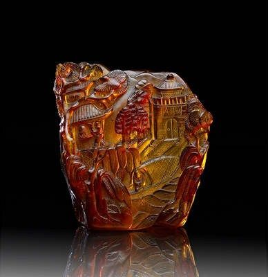 intricate imaginings handcarved in amber