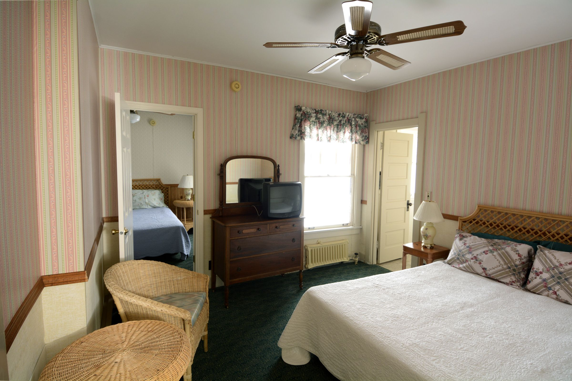 Adjoining rooms have one queen bed adjoining one queen bed