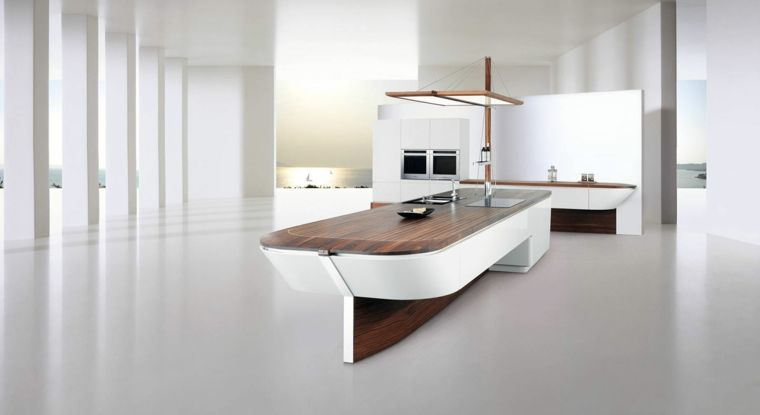 Esempio di cucine moderne con isola a forma di barca con top in