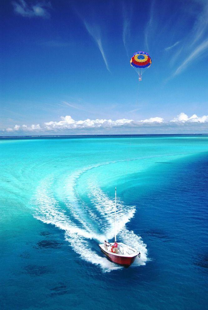 lifelist go para sailing over turquoise blue waters and enjoy the exhilarating view bucketlist httpfacebookcominspiringlifelist