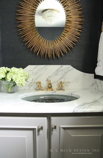Beautiful Powder Room Features Walls Clad In Black Grasscloth By Phillip Jeffries Lined With An Oval Gold Sunburst Mirr Powder Bath Powder Room Bathroom Decor