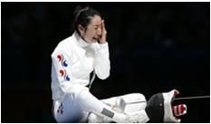 217c: The photographer was clearly trying to capture a certain moment and emotion, not trying to paint a contextual picture. Just like the last photo on Paris Match, we have another athlete sitting on the ground crying in assumed defeat. Also just like the last athlete, she's wearing white on an entirely black background to make her emotions pop even more.