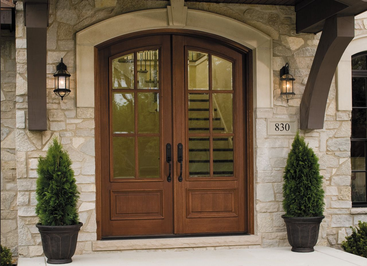 Give Your Home European Elegance With A Rustic Wood Entry Door