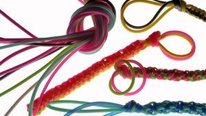 Gimp is a flexible plastic lace used to make lanyards and keychains.