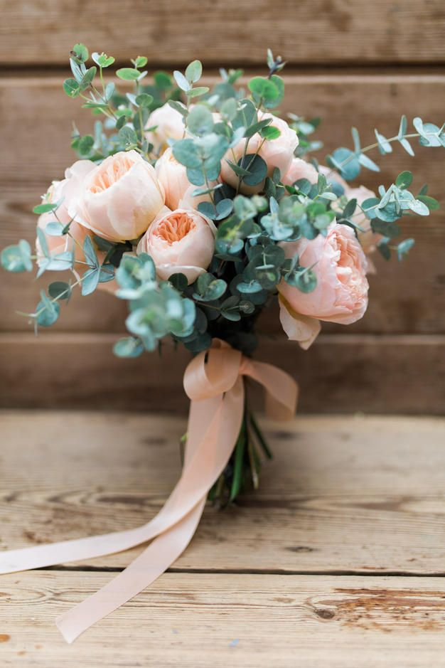 Pink summer rose wedding bouquet with pink ribbon.