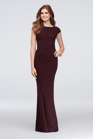 This sleek scuba-crepe sheath dress is simple from the front and ...