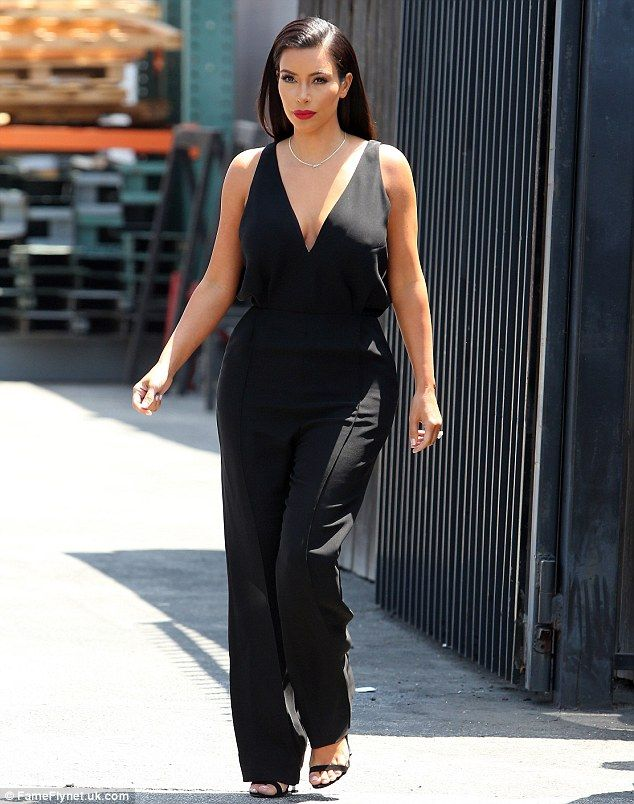 a3bd828051a Kim Kardashian showcases svelte figure in black jumpsuit at glam ...