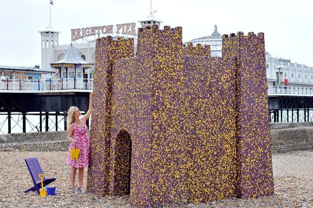 Crazy! 10' tall sand castle made of 90,000 Dairy Milk Pebbles on #Brighton beach over Aug bank hol!