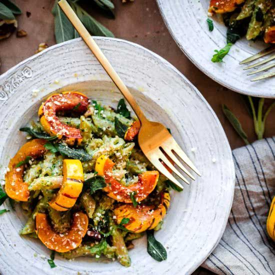 Whole Wheat Pasta with Walnut-Sage Pesto and Roasted Delicata Squash. An easy, weeknight vegetarian pasta for fall!