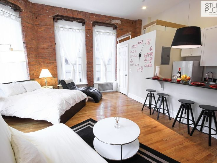 Wow This Is An Amazing Looking Studio Apartment Brick Walls And The Wall Clock Are Notable Features Very Clean Layout