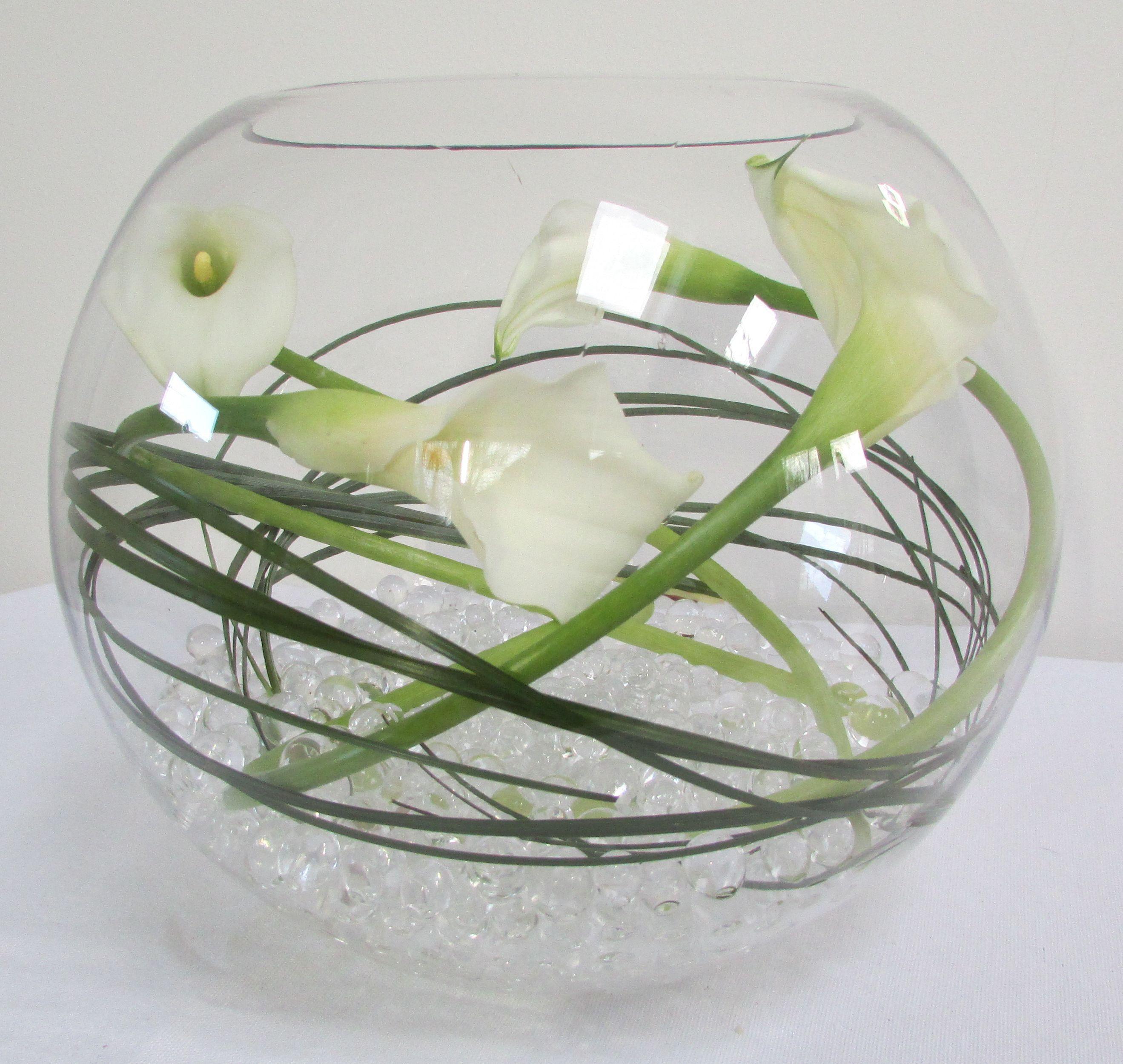 White calla lillies in large goldfish bowl g