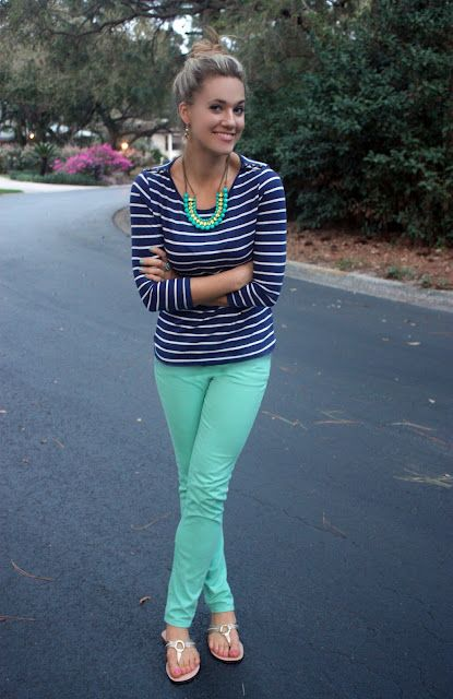 mint green skinny jeans, stripe t-shirt with a bright colored necklace, lilly sandals