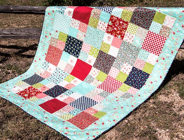 Learn how to make this sweet Layer Cake Checkmate quilt with our ... : quilts to make with layer cakes - Adamdwight.com