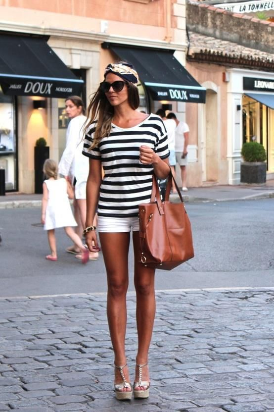 Choose a monochrome striped crew-neck t-shirt and white shorts for a Sunday lunch with friends. A pair of gold leather wedge sandals will seamlessly integrate within a variety of outfits.   Shop this look on Lookastic: https://lookastic.com/women/looks/crew-neck-t-shirt-shorts-wedge-sandals-tote-bag-sunglasses-headband-bracelet/12430   — Black Print Headband  — Black Sunglasses  — White and Black Horizontal Striped Crew-neck T-shirt  — White Shorts  — Black Bracelet  — Tobacco Leather Tote…