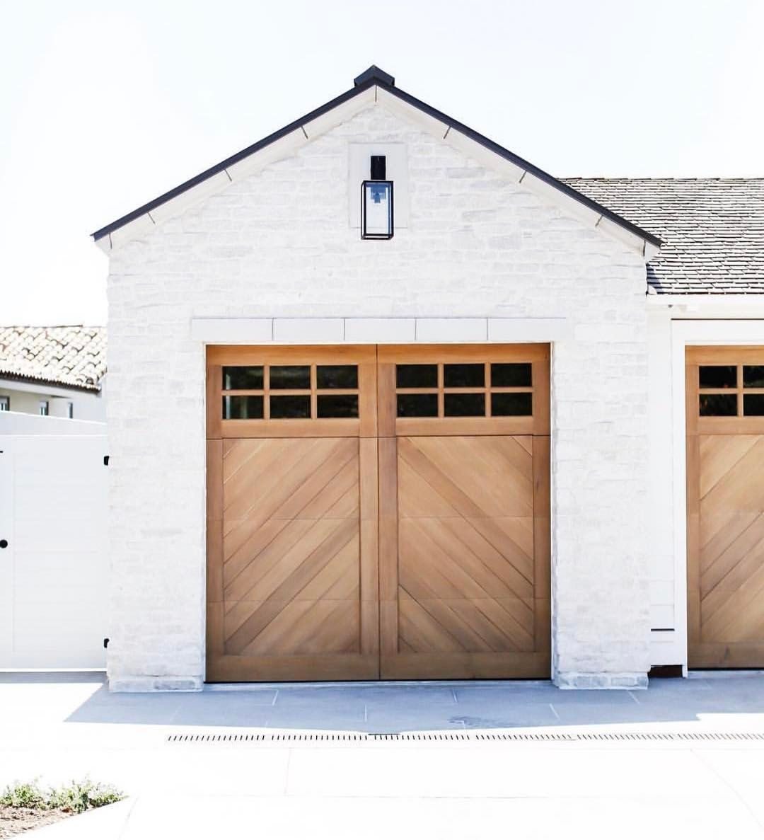 This is just so perfect natural wood garage on a white Brick and wood house