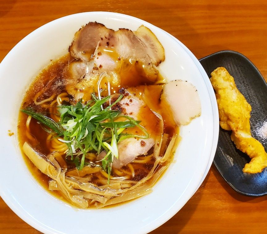 Shoyu Ramen .. my favourite local ramen at the moment. Shoyu (soy sauce) chicken broth ramen with char siu (pork), menma (fermented bamboo shoots) and negi (Welsh onion) topping. Served with a side dish of tasty karaage (fried chicken). Oishi!   #travel #foodies #japanese #food #japan #日本 #cuisine #washoku #和食 #foodtoursjapan #ramen🍜 #ramenaddict #shoyuramen🍜 #soysauceramen #ramen #ラーメン  #醤油 #ramenlover #japaneseramen #osaka #大阪市 #japanesefood #唐揚げ #karaage #ramenstagram #foodpornjapan