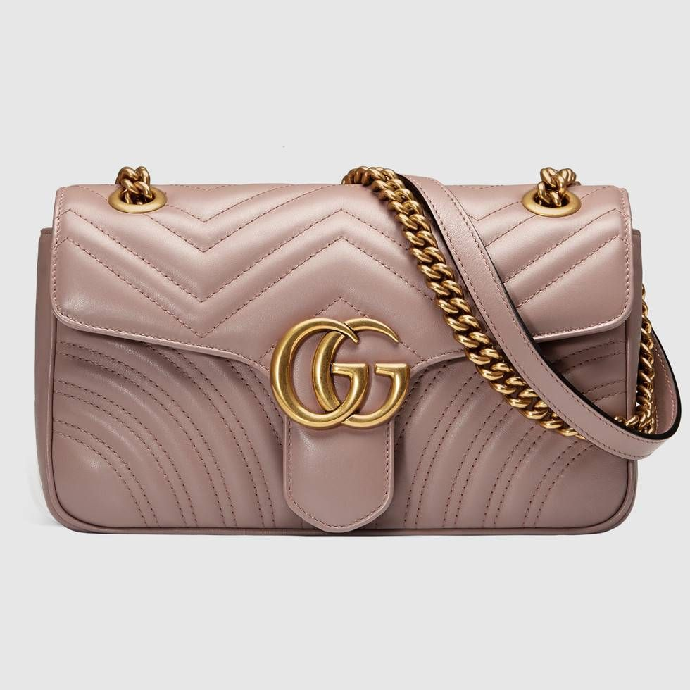 91d70d1a6de0 Shop the GG Marmont matelassé shoulder bag by Gucci. The small GG Marmont  chain shoulder bag has a softly structured shape and an oversized flap  closure ...