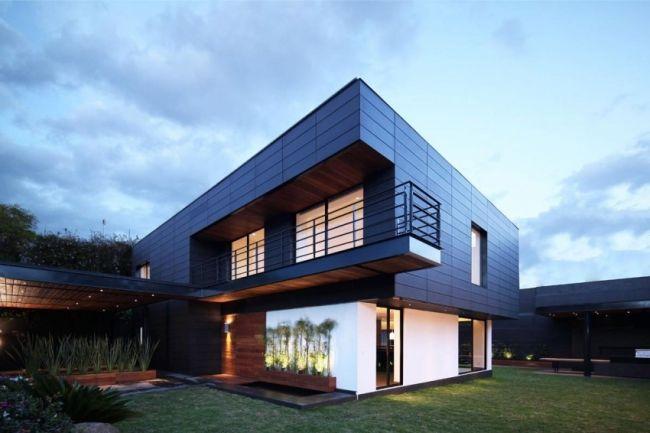 Maison contemporaine avec une façade en céramique NBK Architecture