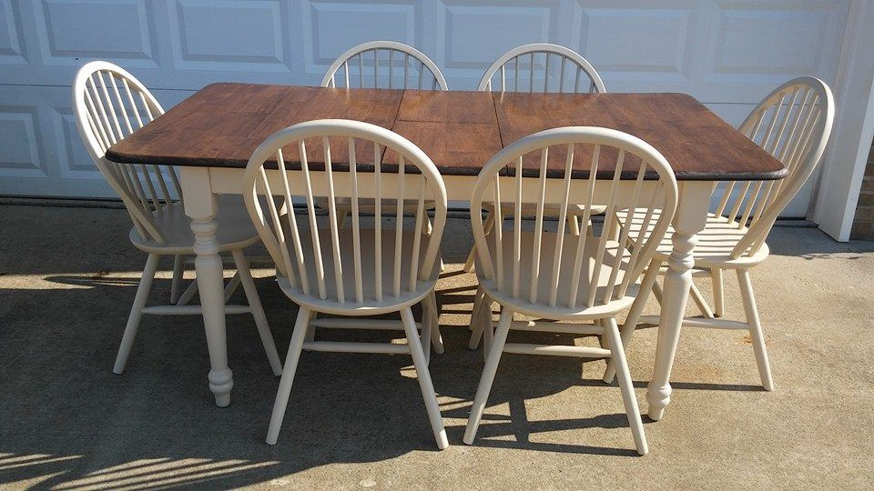 """Beautifully refinished farmhouse kitchen/dining room table w/ 6 matching windsor chairs. I refinished this set in a dark walnut stain by rust-oleum and newly painted it a cream color. The table comes with one small butterfly leaf and can tuck under table. The table with leaf out measures 65"""" x 36"""". Leaf measures 12"""". Excellent condition. Designed by Just Tables and Chairs"""