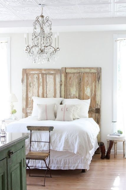 Easy and inexpensive headboard idea. Love the green cupboard, chandelier and simple white bedding. How inviting for guests.