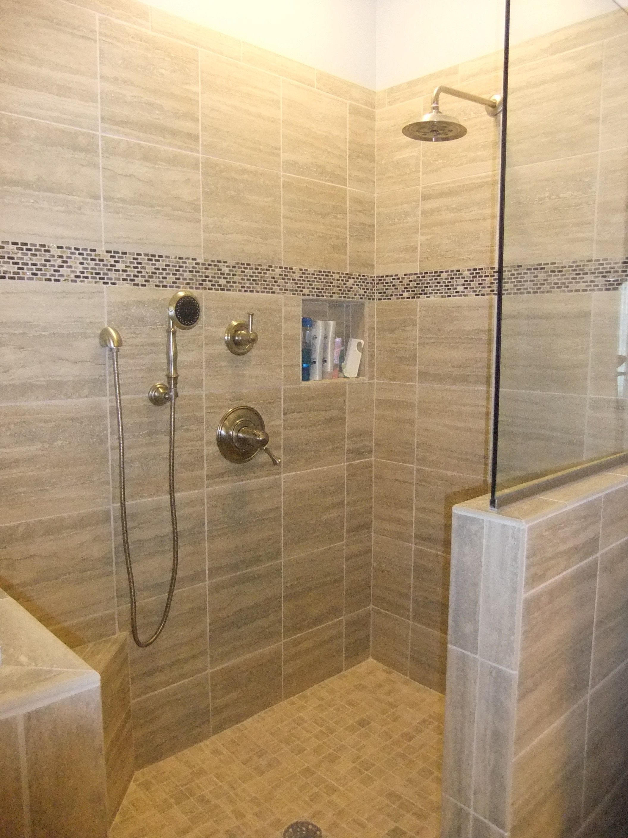 The White Seat Also Ties The Bench To The Mosaic Tile Niches And River Rock Tile Floor De Small Bathroom With Shower Showers Without Doors Tile Walk In Shower