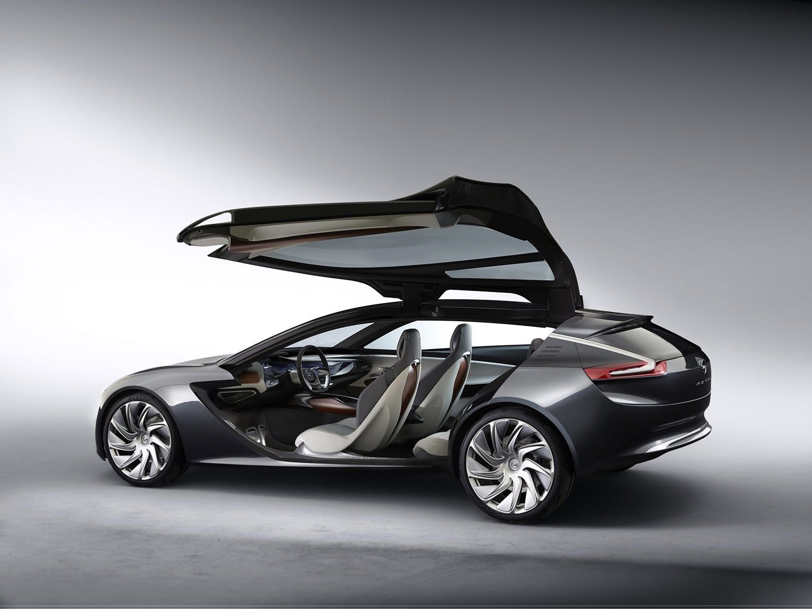 New Monza Concept Is Opel S Idea Of A Coupe With Wings For Doors Concept Cars Futuristic Cars Concept Car Design