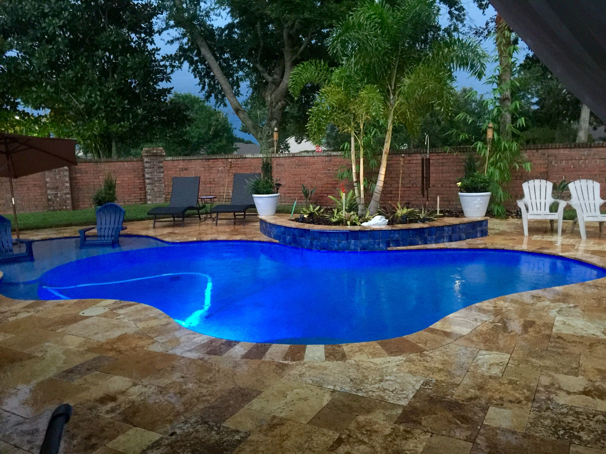 The Lagoon Pool I Designed And Love Travertine Tile Dark Blue Water Line Blue Lighting And During The Day The Bottom Of The Pool Blue Pool Pool Pool Lights