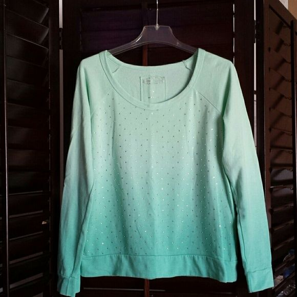 Ombre sweatshirt with rhinestones It's a mint color with sparkly rhinestones all over the front. All stones are intact. Very cute. In good condition. Maurices Tops Sweatshirts & Hoodies