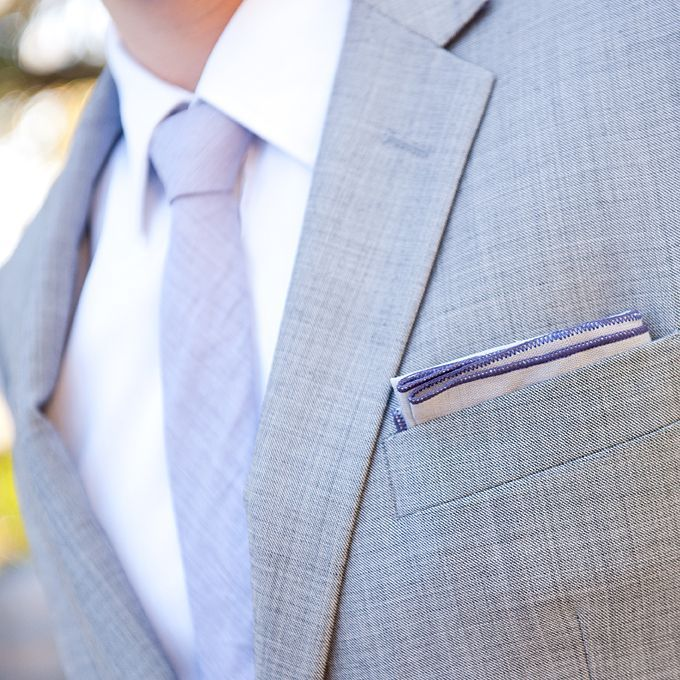 A California Wedding with a Lavender and Gray Color Palette. Brad paired a gray Indochino suit with a purple tie from Theory.: A California Wedding with a Lavender and Gray Color Palette. Brad paired a gray Indochino suit with a purple tie from Theory.